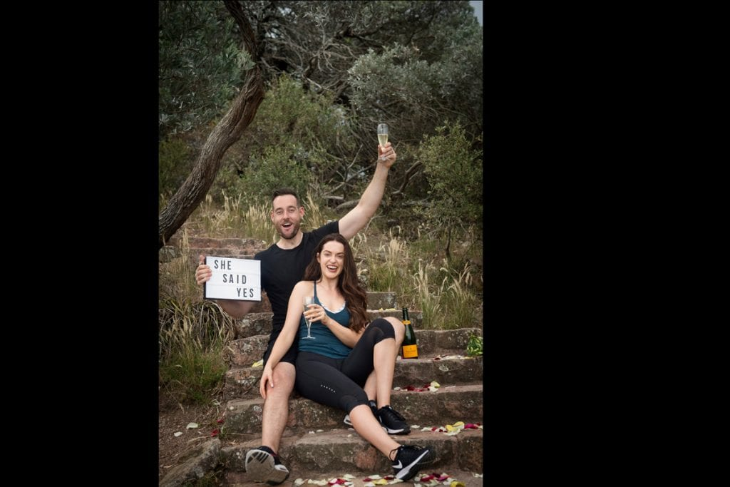 she said yes, happy couple after wedding proposal on the mountain