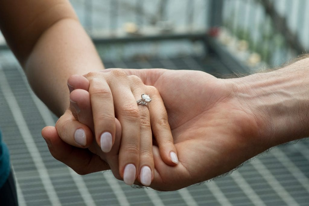 showcasing beautiful wedding rings after being proposed