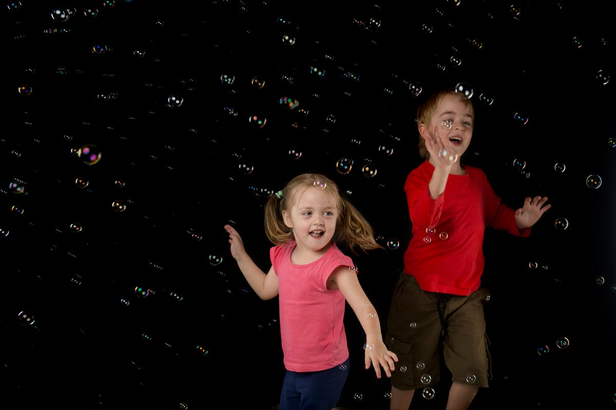 Catching bubbles from professional bubble machine during shoot in the photography studio