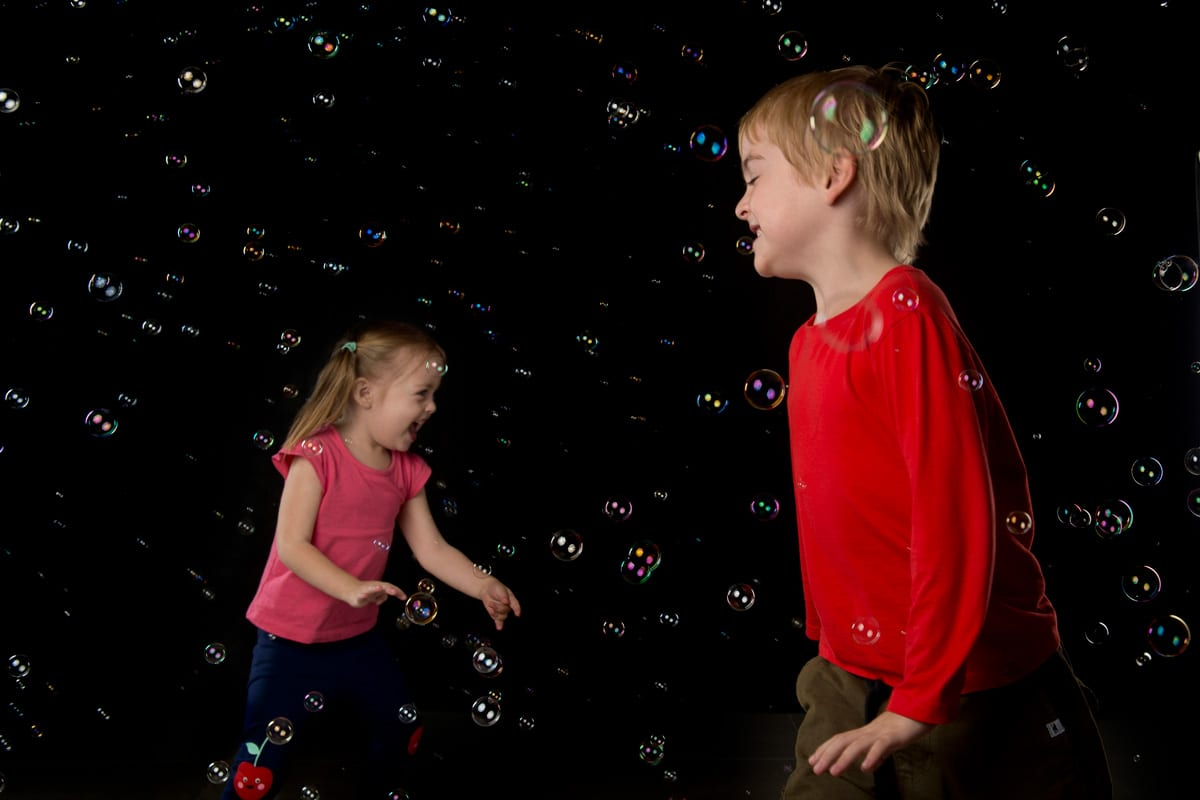 Children having fun at bubble photo shoot in the photography studio