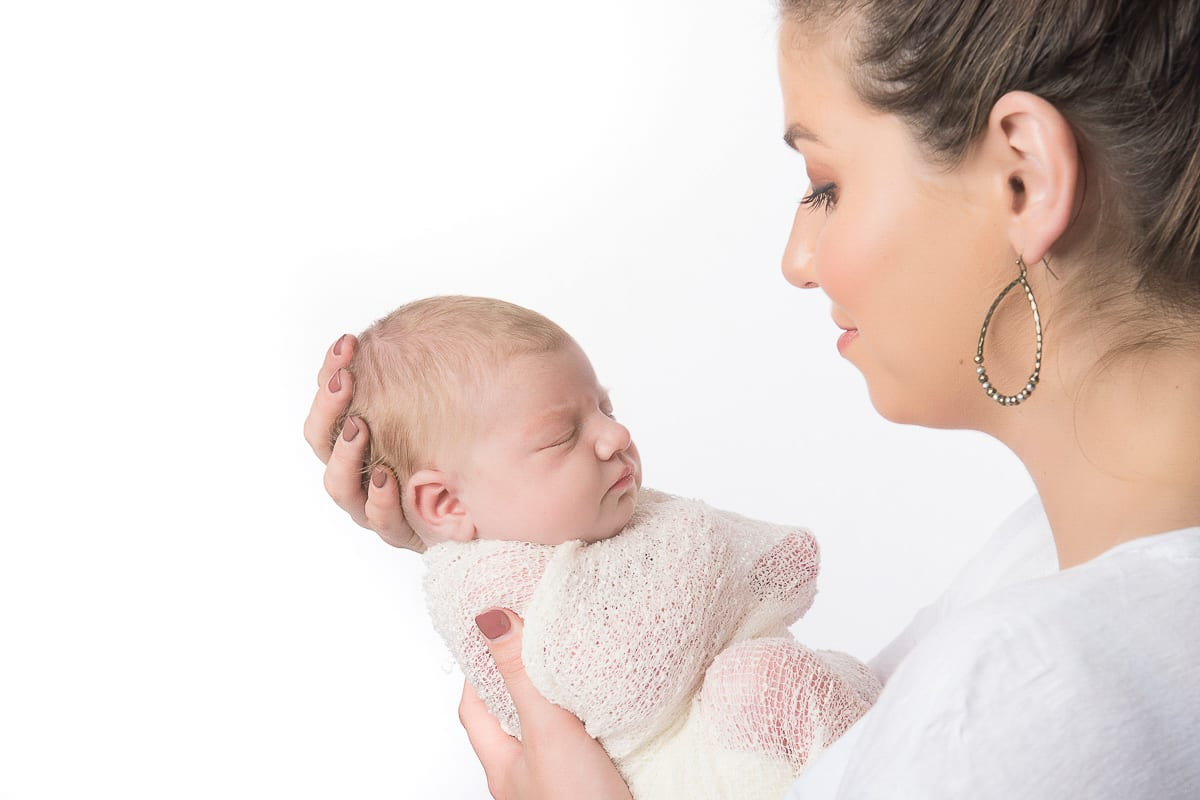 little baby just born at a newborn photoshoot