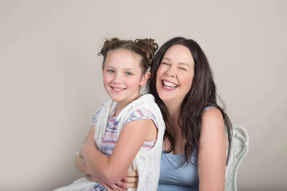 mother and daughter during studio family portrait session