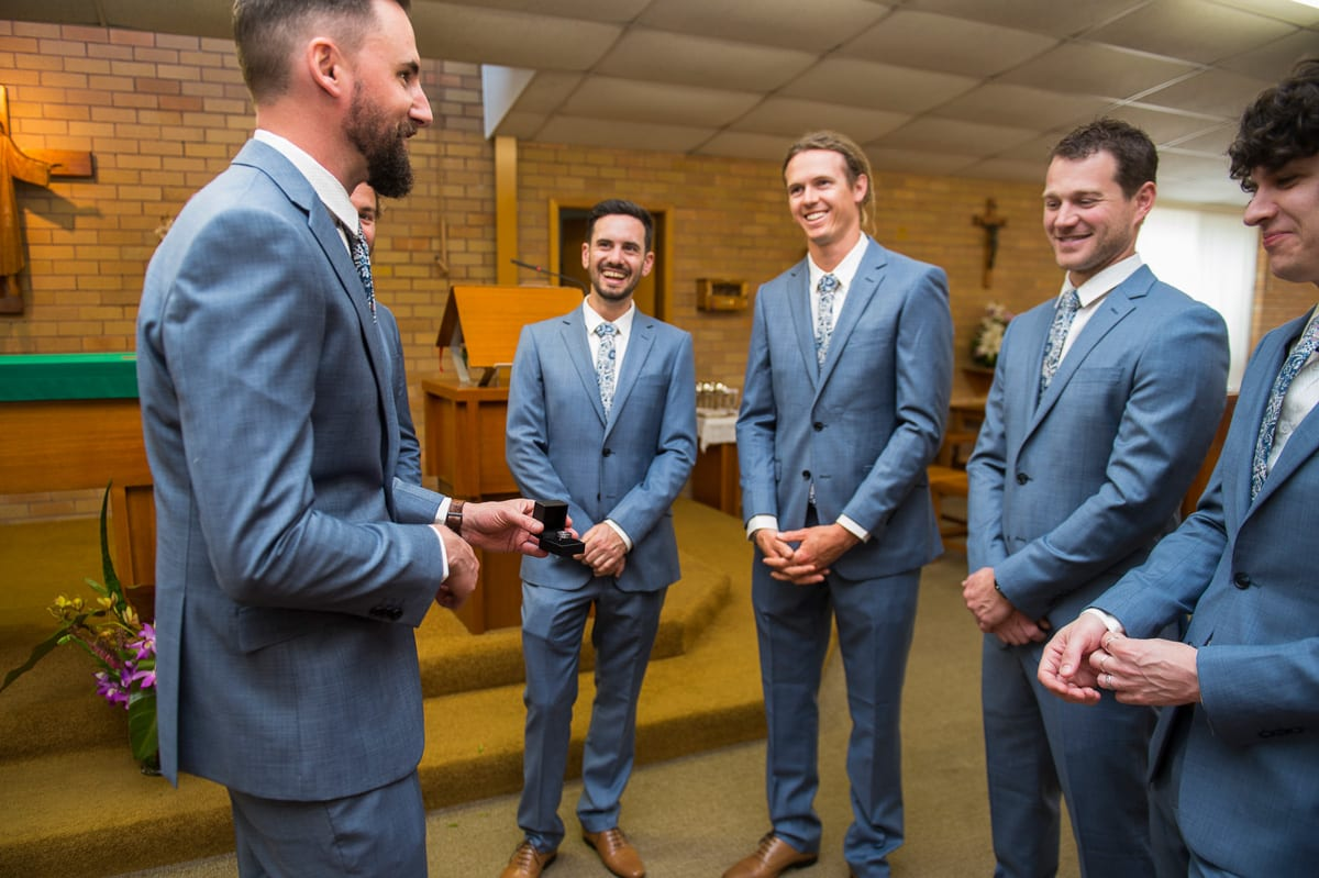 boys showing off the wedding ring in Catholic Church nelson bay