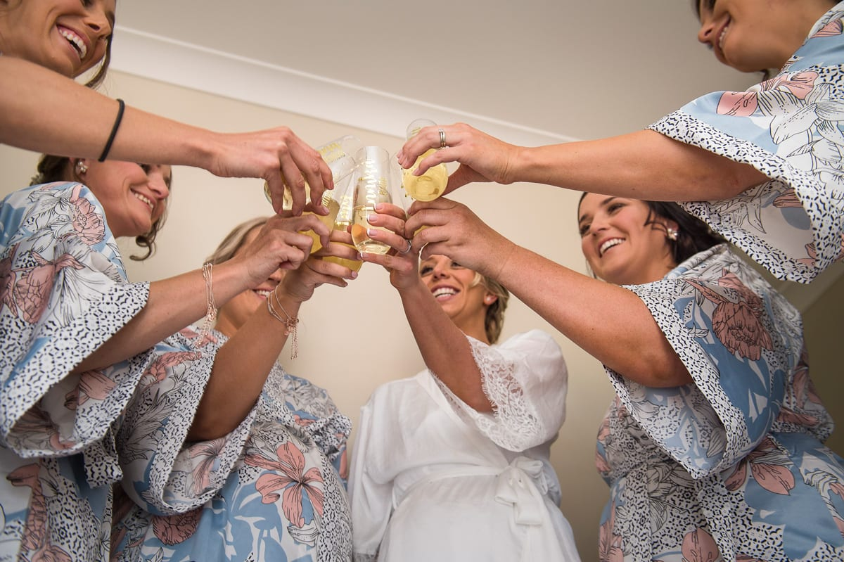 champagne cheers before the wedding starts bridal party