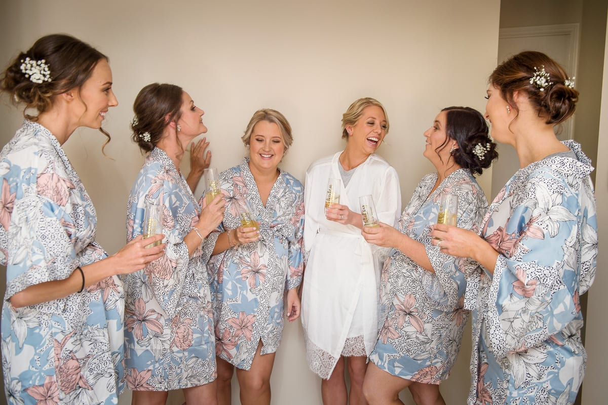 image of bridal party having fun getting ready for the wedding