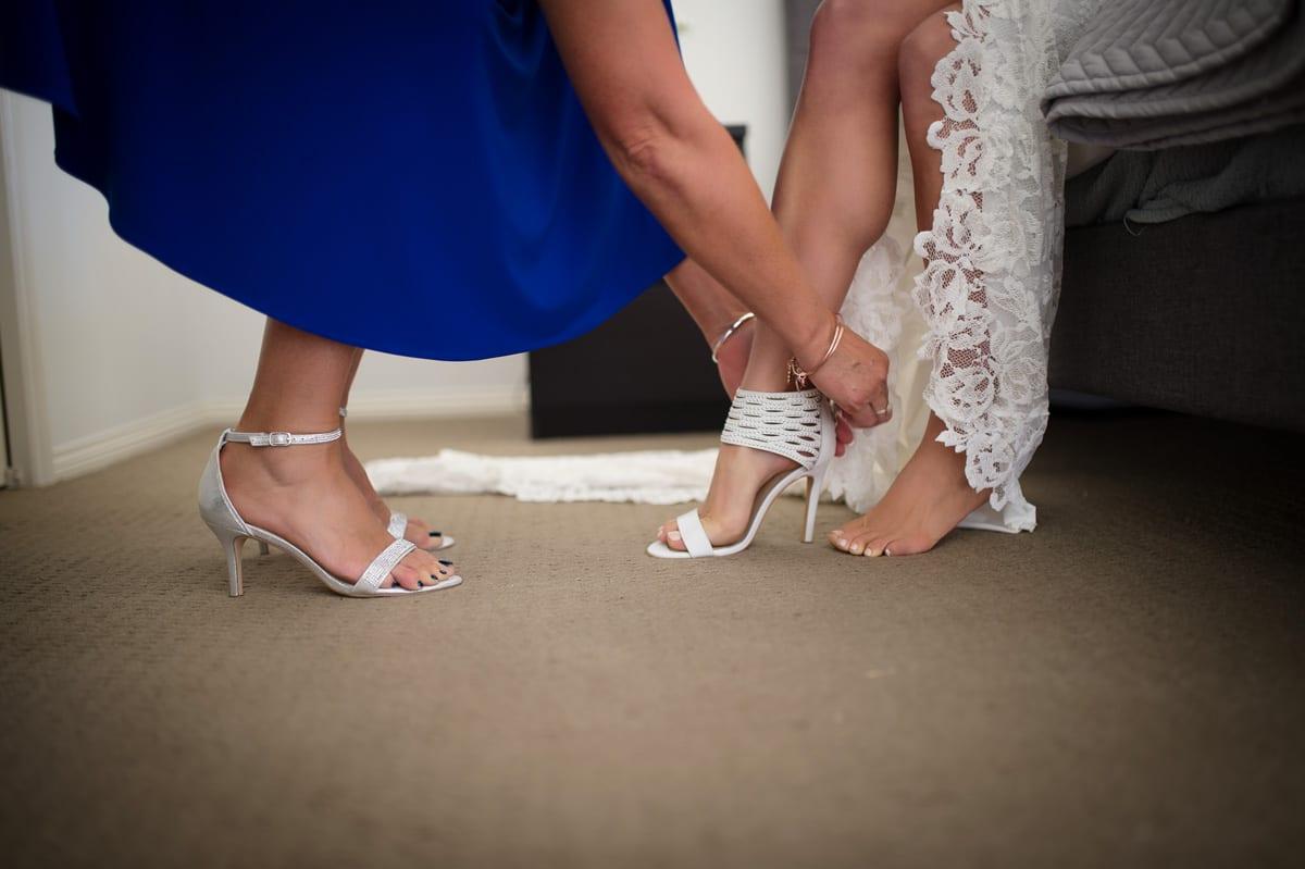 photo of getting wedding shoes on wedding port Stephens