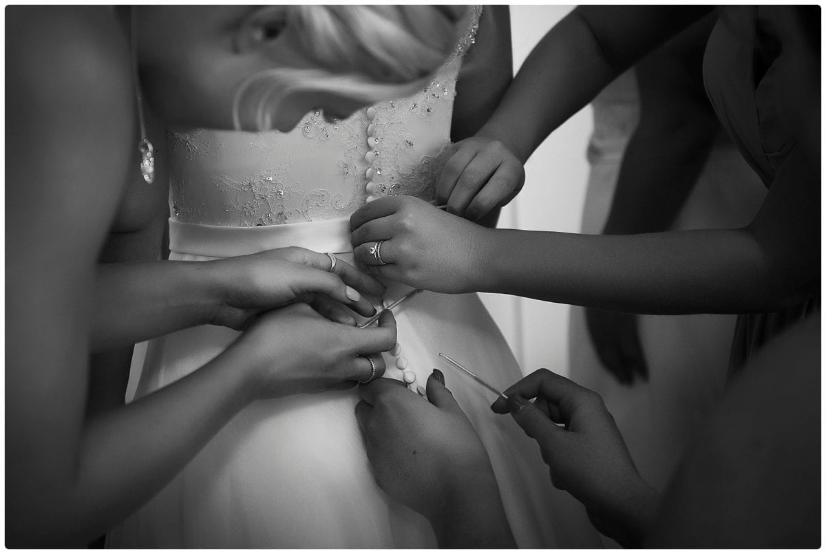 image of getting ready black and white photo of wedding dress Kiralea