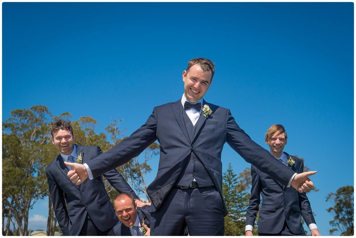 Bridal party on the jetty at little beach port Stephens