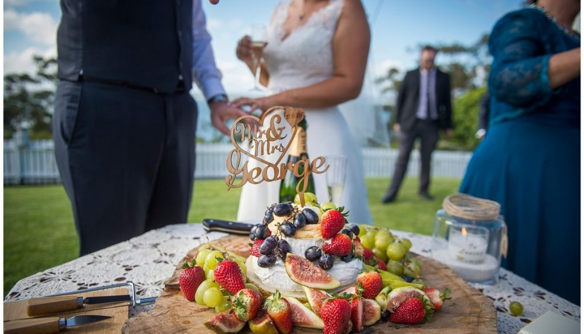 Cutting the cheese cake at the wedding Inner Lighthouse Nelson Bay