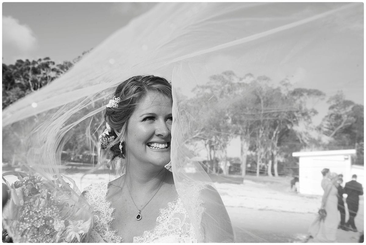 portraits of bride at wedding portraits at jetty little beach after wedding ceremony at Inner Lighthouse Nelson Bay
