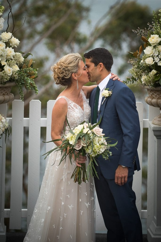 kiss of bride and groom at inner lighthouse nelson bay